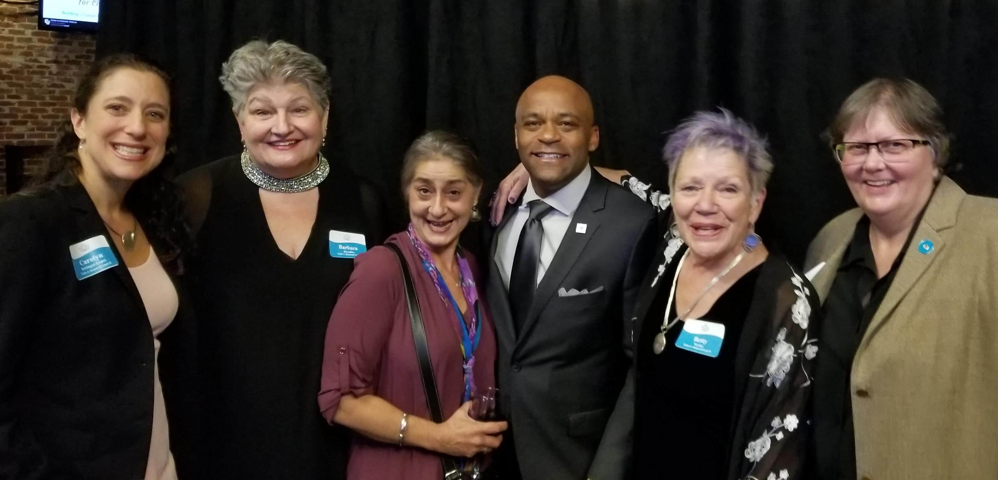 Group photo of honored guests at Champions for Change event