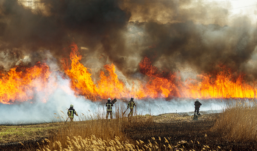 A worker scales a pile of rubble in the aftermath of a disaster